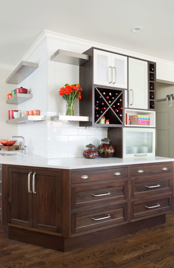 kitchen with brown base cabinets and open silver shelving, custom upper cabinets feature wine racks and a bread box