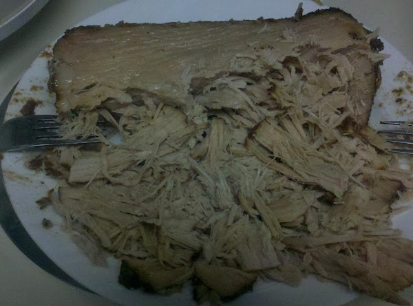 When pork is cooked remove from crock pot and shred, dump all fat and...