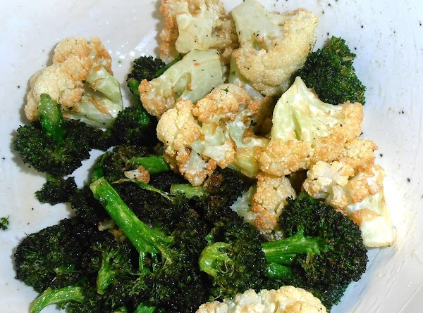 add remaining evoo and greek seasoning to a bowl.  toss broccoli and cauliflower...