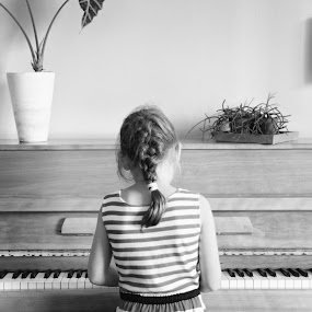 Learning by Ammar Alkhatib - People Musicians & Entertainers ( music, girl, piano, black and white, learn, instrument, notes, people )