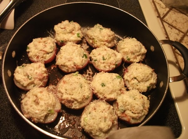 Pour olive oil in a large skillet, with a lid, over medium heat. Put...
