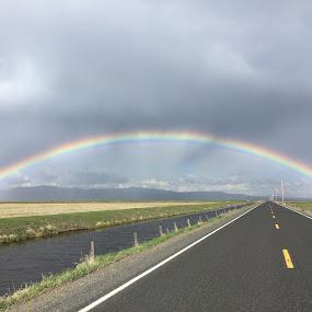 Rainbow Crossing by Tracy Lynn Hart - Landscapes Weather ( ski, weather, travel, rainbow, rain )