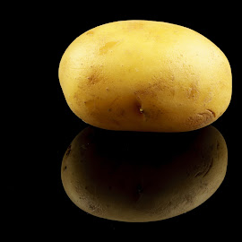 Potato by Maksim Kozlov - Uncategorized All Uncategorized ( salty, isolated, nobody, potatoes, yellow, fried, snack, heap, color, food, crunchy, ripple, potato, fast, black, gourmet, salted,  )