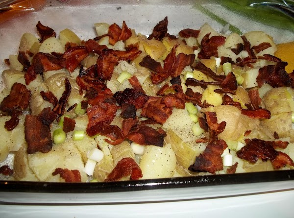 Sprinkle the potatoes with half of the salt, pepper, onions if using and bacon.
