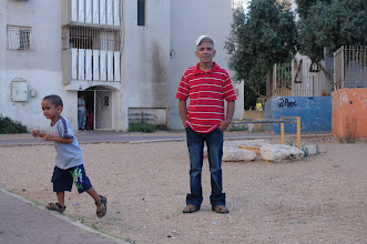 Photo: Sami Kadi, activist and his son Yousef in the shikun of Shem HaGdolim 6, Jaffa