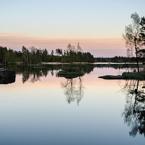 Sunset in the land of 1000 lakes by Nico Sinselmeijer - Landscapes Sunsets & Sunrises ( laitila, reflection, sky, tree, trees, finland, lake, scenery )