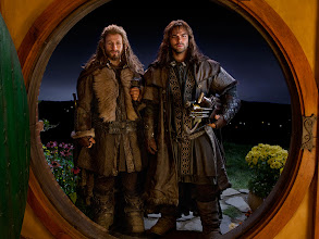 Photo: Fili and Kili arrive at Bag End. Across the Water, we can see other hobbit holes.