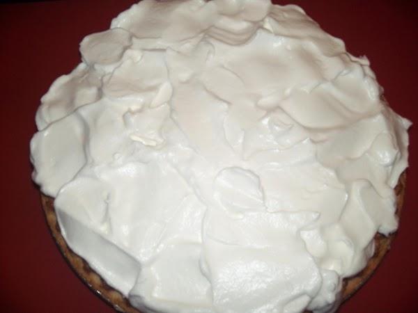 Make meringue. Remove plastic and spread meringue onto pie. Return to oven to brown...
