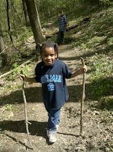 Photo: a few people passed us with walking sticks, so Kaleya decided she needed some too