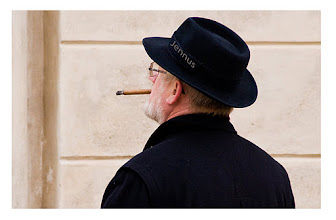 Photo: old man with the black hat and a cigar between his teeth