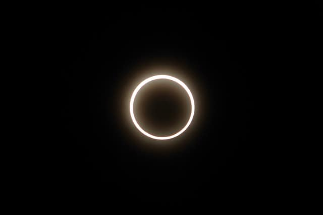 Annular solar eclipse, showing a rind of sun around the moon's shadow