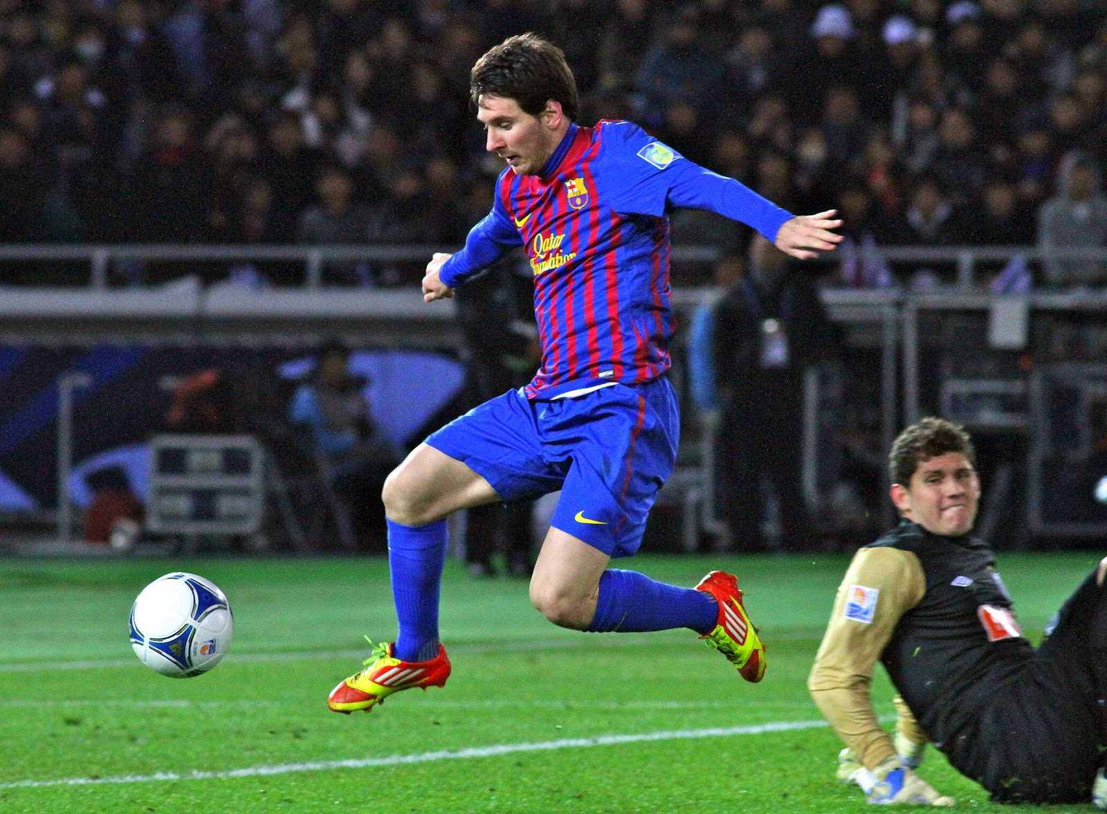 Lionel Messi controls a football while playing for Barcelona