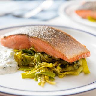 One-Skillet Salmon With Curried Leeks and Yogurt-Herb Sauce.