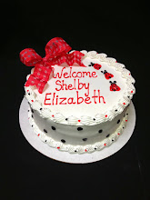 Photo: Lady bug themed baby shower cake - black dots around sides w/little lady bugs drawn on top w/red French ribbon bow.