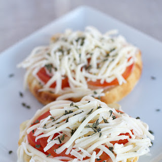 English Muffin with Tomato and Melted Mozzarella Cheese.