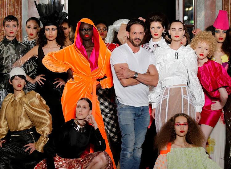 Designer Ronald van der Kemp appears at the end of his haute couture fall-winter 2018/2019 fashion show for fashion house RVDK in Paris.