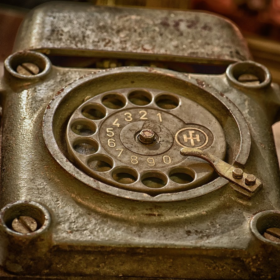 Ruggedized Telephone by Marco Bertamé - Artistic Objects Antiques ( old, vintage, screw, number, round, circle, steel, 3, havy duty, bell, 2, 1, 0, 7, 6, 5, 4, 9, 8, telephone, dial plate,  )