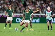 Handre Pollard of South Africa kicks the ball during the Rugby World Cup 2019 Final match between England and South Africa at International Stadium Yokohama on November 02, 2019 in Tokyo, Japan.