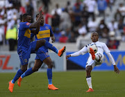 Orlando Pirates winger Luvuyo Memela (R) gets away from two Cape Town City defenders during the Absa Premiership match at Cape Town Stadium on April 28, 2018 in Cape Town, South Africa. Memela picked an injury in this match and has played ever since.