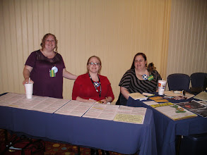 Photo: The dedicated women of Command and Library sit behind the schedule, ready to answer any question!