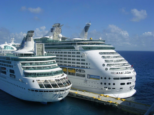Royal-Caribbean-Grandeur-Explorer - Grandeur of the Seas and Explorer of the Seas get cozy. The Royal Caribbean ships appeal to a wide range of cruise passengers.