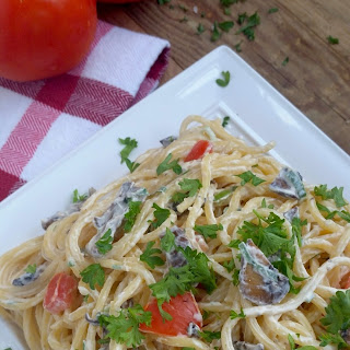 Spaghetti and Cream Cheese Sauce with Mushrooms and Tomatoes.