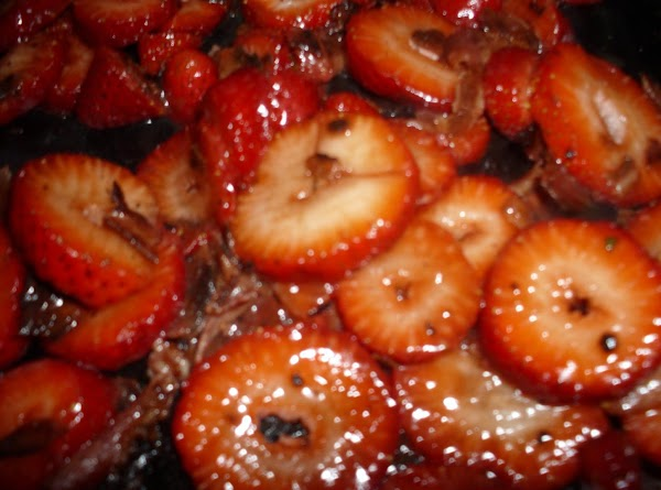 Add the bacon to the mascerated strawberries. Heat up the skillet you fried the...