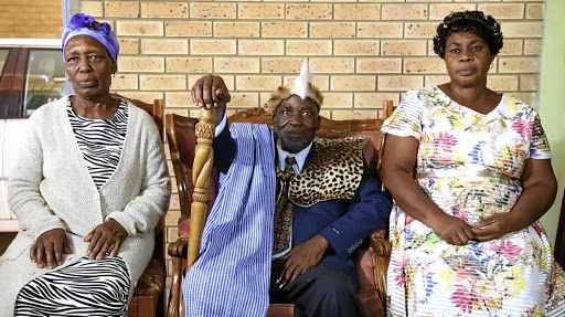 Limpopo businessman Ephraim Masutha with his wives Anna, left, and Maria,  who are sisters.
