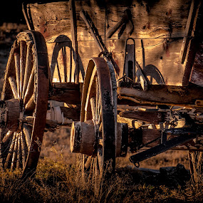 Wheels of the Past by Gary Hanson - Artistic Objects Antiques ( light of day, wagon wheels, wheels, wagon, past, buckboard, shadows,  )