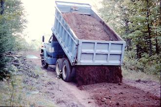 Photo: Spreading gravel