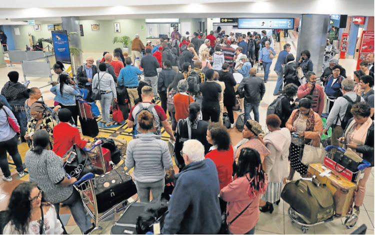 Several travellers were stuck at the East London Airport on Monday after flights were delayed and some cancelled after lightning struck a crucial electronic navigation system.