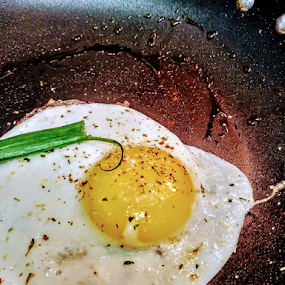 Eggy Weggy by Carlo McCoy - Food & Drink Plated Food ( eggs, lunch, pans, green, black background, grub, yellow, home cook, food photography, green onion, food porn, eating, inside, dinner, food, fried, plated, seasonings, round, one subject, sear, breakfast, sunny side up, indoor photography )