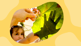 image of young girl playing with leaf