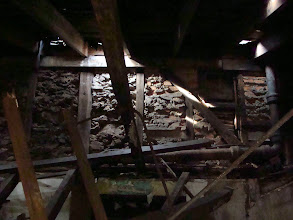 Photo: Section of rear wall exposed showing rubble nogging construction. December, 2011.