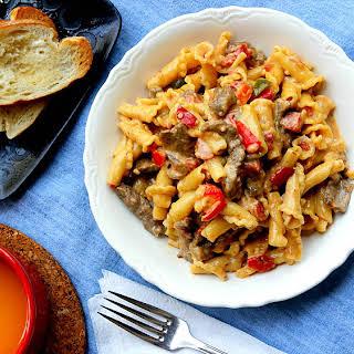 Campanelle Pasta and Steak in Creamy Parmesan Tomato Sauce.