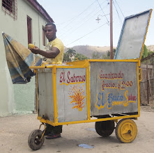Photo: #creative366project Mar 11, 2012  A street peddler.  Certain kinds of small private businesses are legal in Cuba since recently. This young man has a portable Granizado stand (shaved ice with syrup and/or liquors), but he is not beyond selling fresh fruit as well. The Mango was delicious.