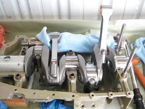 Photo: Rods fitted into place, crank bearings in place, camshaft in place with tappets in their bores.  lint free cloths to keep rods from damaging themselves or other parts if they swing down.