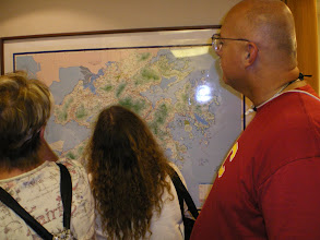 Photo: The Martinez and Judy Edwards view a map of Hong Kong