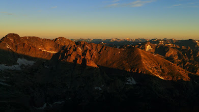 Photo: You watch as the mountains shed the night.