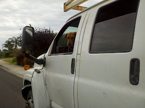 Photo: There is a big dose of road construction going on in my neighborhood, and for the last couple of days I've seen this pooch hanging out in his owner's truck while the owner drops off big equipment.  The dog wasn't too sure about me being so close...