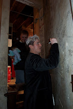 Photo: PJ writing on the wall for the first time