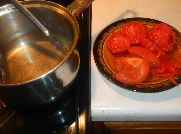 Remove tomato skins. Dipping them in boiling water will do the trick,remove and cool.