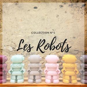objet déco en béton avec ces figurines décoratives en forme de robot fait en béton coloré à la main par la créatrice d'objet déco en béton Junny