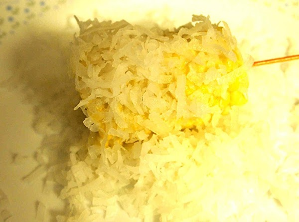 Dredge the corn with the coconut shredded coconut flakes. Enjoy!