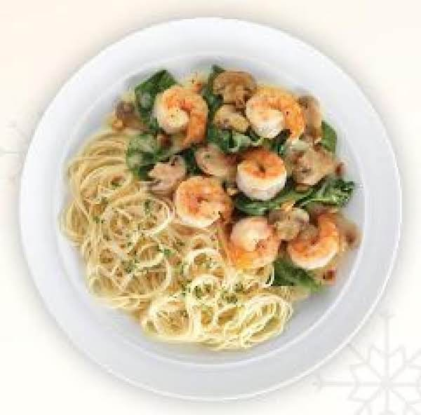 Shrimp Sauteed With Fresh Spinach, Mushrooms, And Pine Nuts - Topped With A Lemon-butter Sauce, And Served With Capellini Pasta.