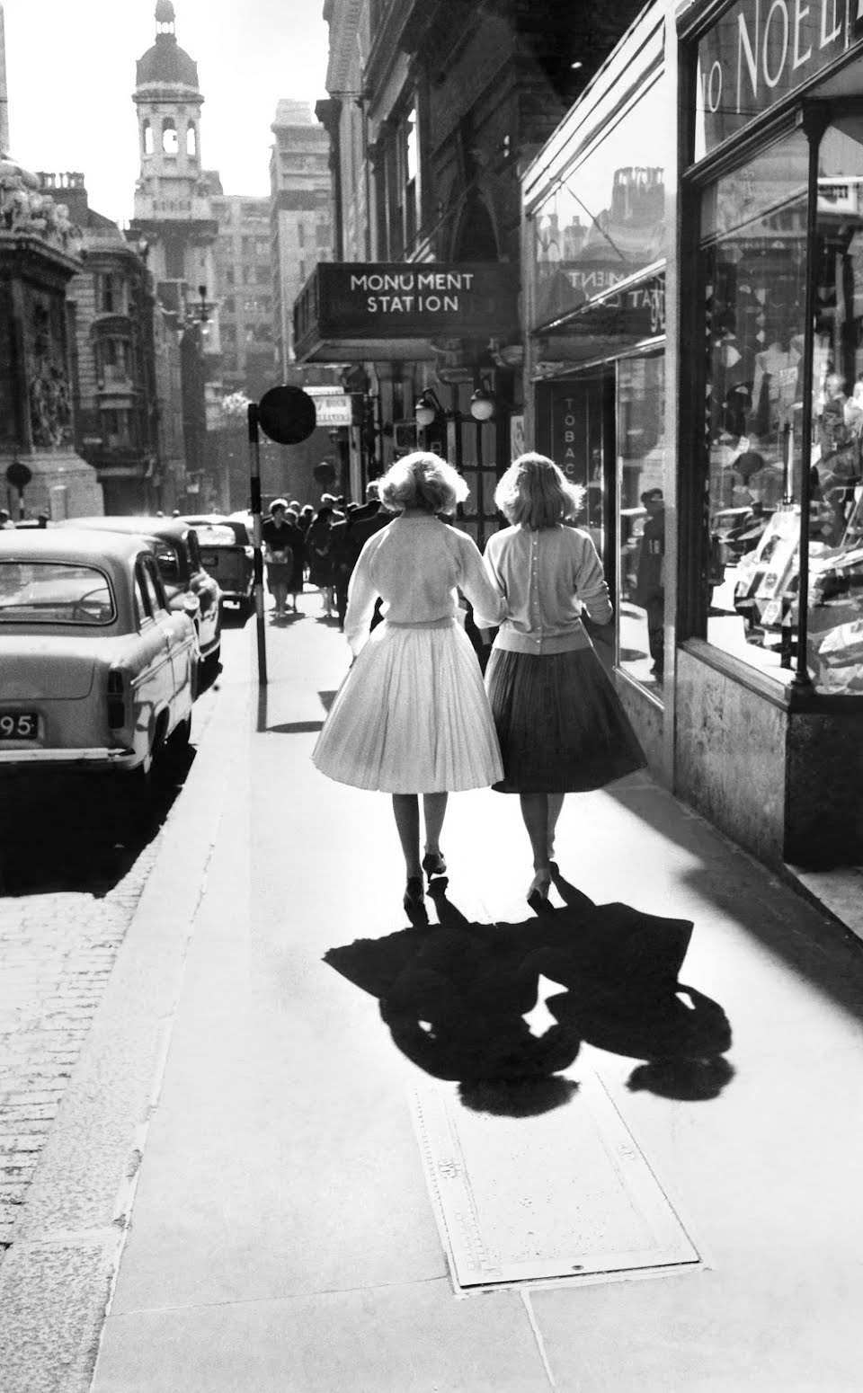 Twin sisters walking towards the Church of St. Magnus the Martyr in London in the 1950s