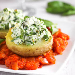 Spinach And Ricotta Stuffed Potatoes With Tomato Sauce.