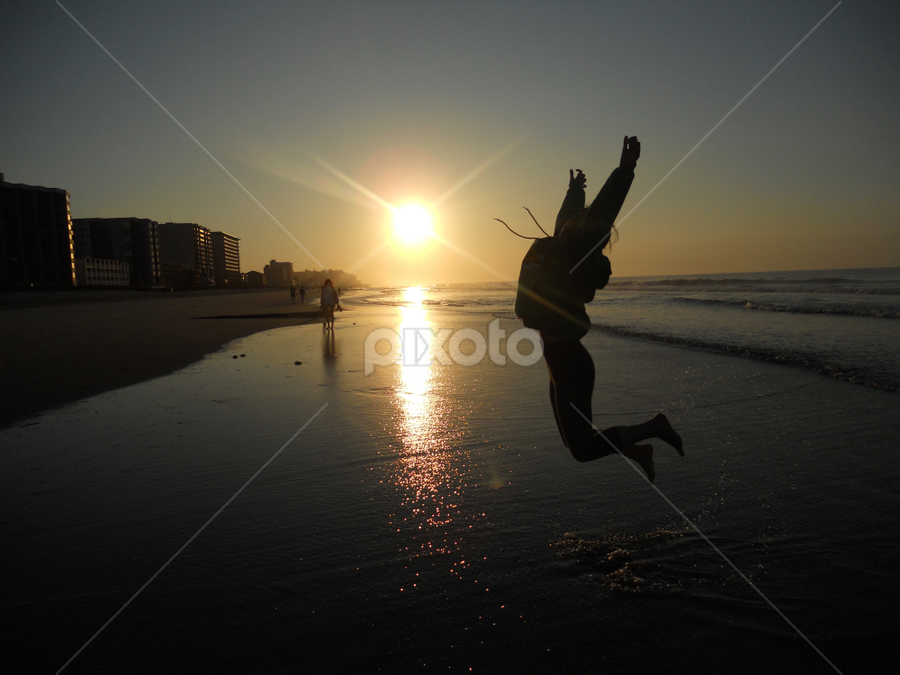 by Calvin Farley - Landscapes Sunsets & Sunrises ( beautiful, lady, sunrise, beach, jump )