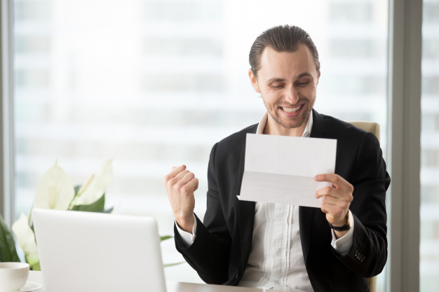 happy man receiving good news about his business