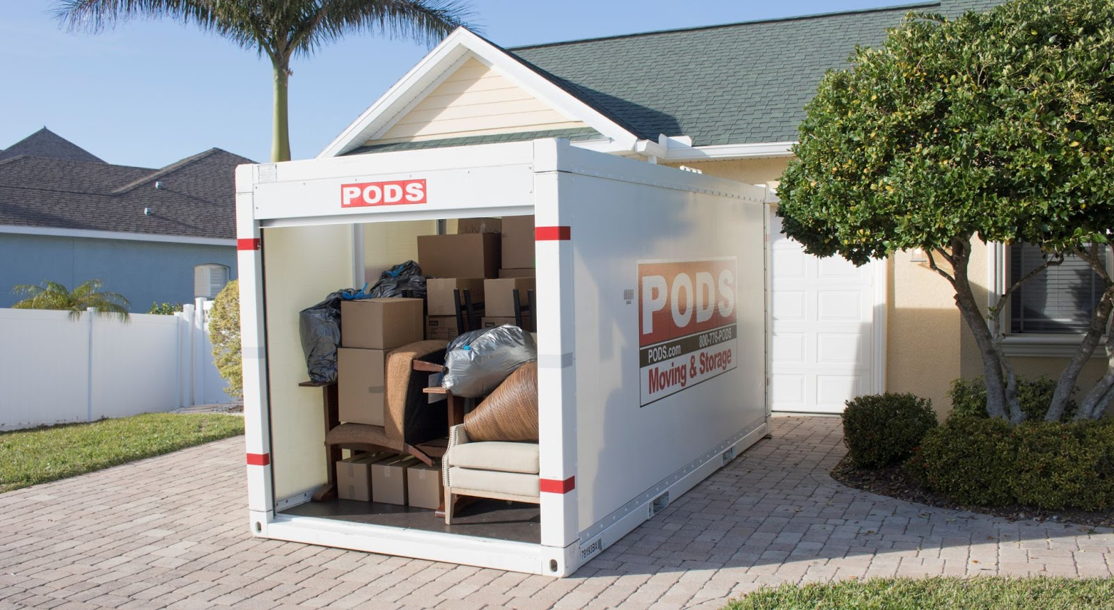 a PODS portable storage container loaded with boxes and furniture